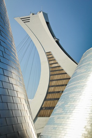 MONTREAL  CANADA - SEPT 05: Olympic stadium between modern buildings on september 05, 2014 in MONTREAL