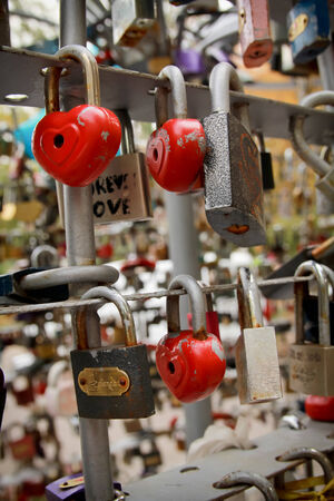 secure: Bridge full of different padlocks with words on it representing secure friendship and romance Stock Photo