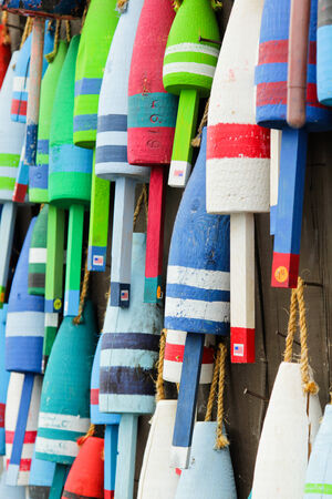 floats: Colorful buoys on a wall of a shake in Maine, USA