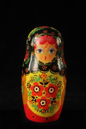 Russian doll on a black backeground