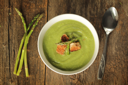Asparagus soup on a wooden background