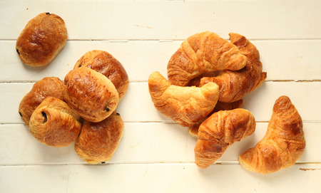 pastry: Croissant and chocolate bread, french pastries on white wooden background