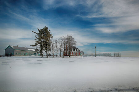 colorectal: Farmhouse and building during winter season in Beauce area near Quebec, Canada