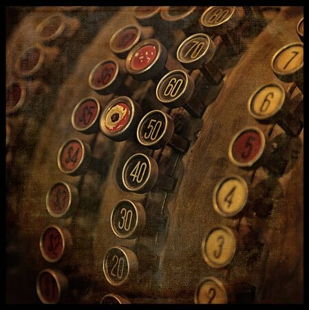 Ancient cash register with texture. Cross processed to look like and instant picture.