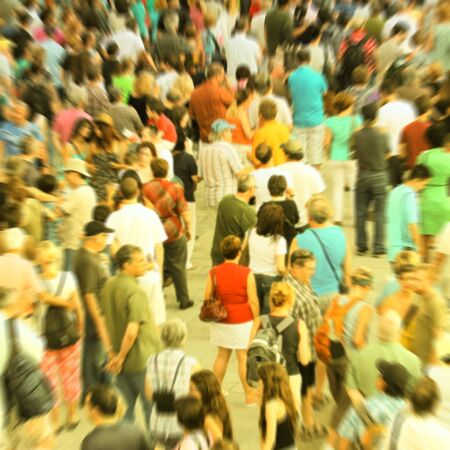 alone in crowd: Blur background showing a crowd. Crossed process to look like an instant picture.