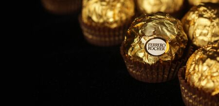 "ferrero: MONTREAL, CANADA - FEBRUARY 05, 2015: Ferrero Rocher chocolate is a sweet made by Italian Ferrero Spa. Rock comes from French and means clustering  ""rock "" after a grotto in the Roman Catholic shrine of Lourdes."