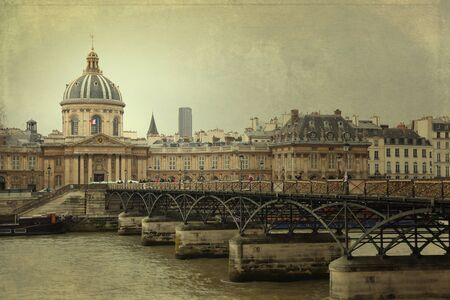 qui: Institute of France in front of the Pont des Arts or Passerelle des Arts is a pedestrian bridge in Paris qui crosses the River Seine. Cross processed to look like an aged instant picture with texture.