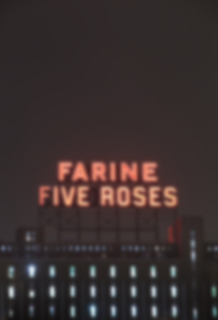 industrial heritage: MONTREAL CANADA JANUARY 25 2015: Icon of the industrial heritage of Montreal, neon Farine five roses blurred and illuminated Montreal since 1948.