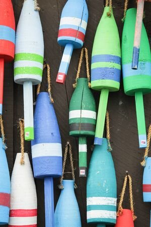 floats: Colorful buoys on a wall of a shack in Maine, USA