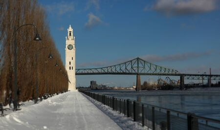 jacques: Clock tower and Jacques Cartier bridge during winter in the old Port Montreal Stock Photo