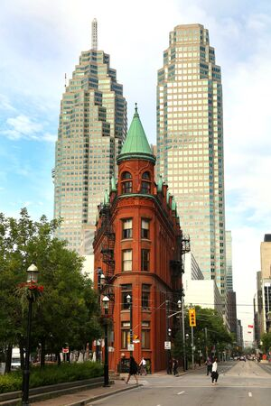 focal point: TORONTO CANADA JULY 10, 2015The red-brick Gooderham Building is a historic landmark of Toronto, Ontario, Canada and is the focal point of one of Torontos most iconic vistas.