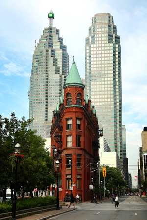 redbrick: TORONTO CANADA JULY 10, 2015The red-brick Gooderham Building is a historic landmark of Toronto, Ontario, Canada and is the focal point of one of Torontos most iconic vistas.