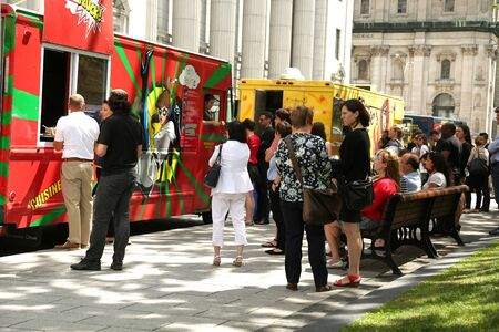 truck: MONTREAL, CANADA - JULY 23, 2015: People waiting for their lunch at food trucks into the business area in Montreal, Quebec on july 23.