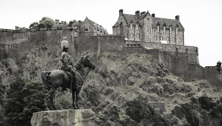 greys: Equestrian monument to the Royal Scots Greys at the Princes Street Gardens with Edinburgh castle in background Editorial