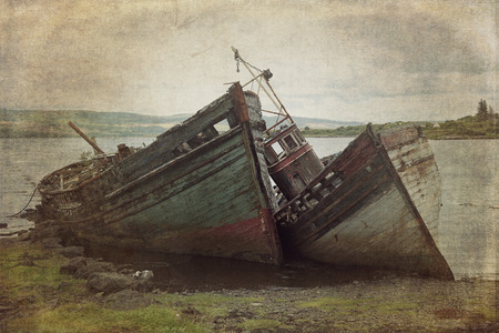 Two old wooden boats aground on isle of Mull, Scotland.