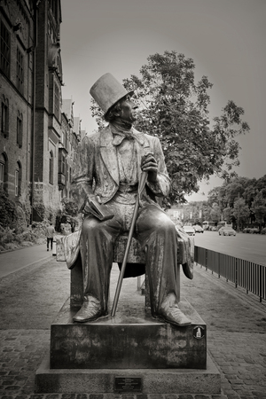 remembered: COPENHAGEN, DENMARK-SEPT 3, 2015: Sculpture of Hans Christian Andersen a prolific writer of plays, travelogues, novels, and poems, Andersen is best remembered for his fairy tales.  Black and white.