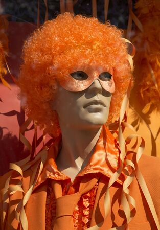 manequin: Mannequin in store with orange wig, mask and orange outfit ready for halloween party