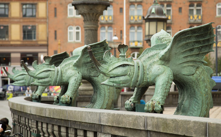 apparently: Sculpture of three dragons at town hall in Copenhagen, Denmark.  Apparently, they have to scare those who go to City Hall to complain.