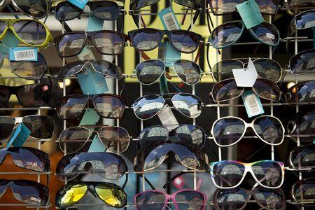 sunnies: COPENHAGEN, DENMARK-SEPT 3, 2015:  Display full of new sunglasses on sale in a street of Copenhagen into the old area.