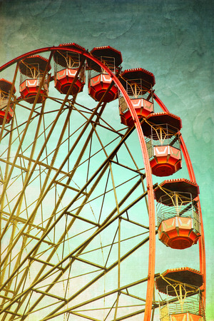 observation wheel: Vintage retro red ferris wheel.  Cross processed to look like and instant picture with texture. instagram style Stock Photo
