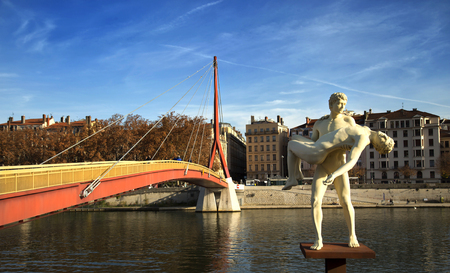 oneself: LYON-FRANCE NOVEMBER 14, 2015: The Weight of Oneself created by Elmgreen and Dragset representing a man carrying his double.  Inaugurated september 2th 2013 next to the passerelle du palais de justice. Editorial