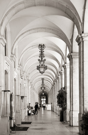 commerce: Arcades with lamps at commerce square in Lisbon, Portugal