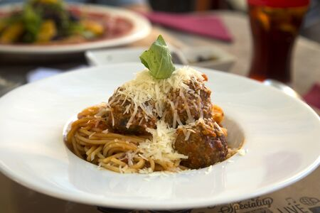 spaghetti sauce: Meat balls with bolognese spaghetti sauce in a white plate