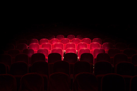Follow spot on red seat in a generic theater