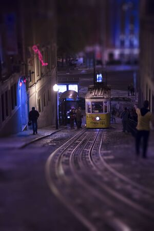 night shift: Yellow tramway at night in Lisbon, Portugal.   Tilt shift effect.