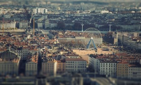 tilt: View of the city centre and the Ferris wheel at place Bellecour in Lyon, France.   Tilt shift effect.