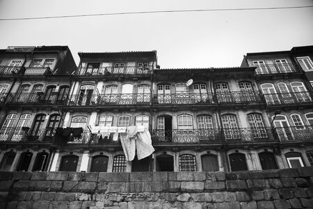 Houses and building along the Douro in Porto, Lisbon.  Black and white picture.
