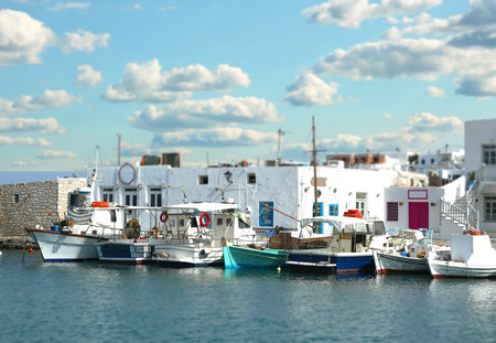 tilt and shift: Fishing boats at the marina with tilt shift effect in Naoussa, Paros island in the cyclades, Greece