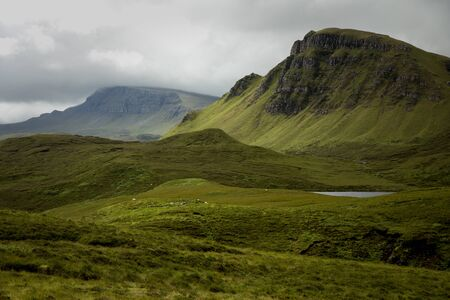 skye: Quiraing mountain on isle of skye, Scotland by a beautiful summer day. Stock Photo
