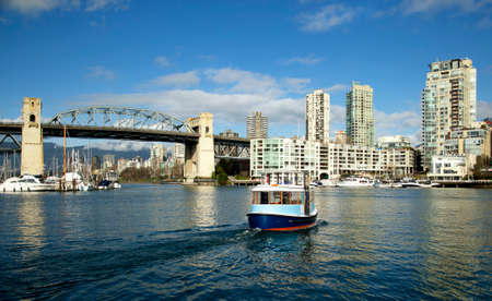 city park boat house: Ferry crossing Granville island to downtown with Burrard bridge in background in Vancouver island