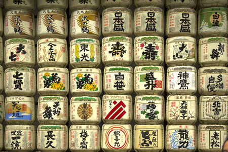 maintaining: TOKYO-JAPAN, 19 June 2016:  Sake barrel offered every year to enshrined deities to stating their humble gratitude and pray to maintaining this traditional japanese culture in Tokyo, Japan. Editorial