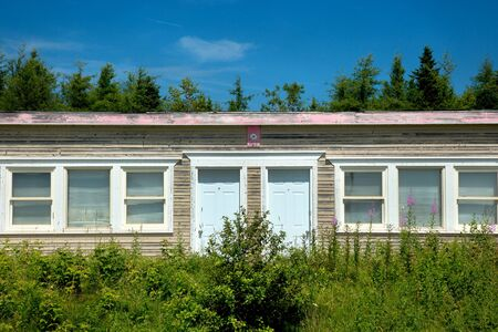 Abandoned motel in a countryside with a blue sky full of clouds