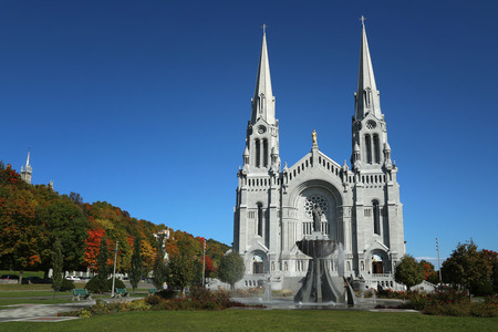 credited: QUEBEC-CANADA 16 SEPT 2016: Basilica of Sainte-Anne-de-Beaupre during fall season in Quebec, Canada.  It has been credited by Catholic church with many miracles of curing the sick and disabled.