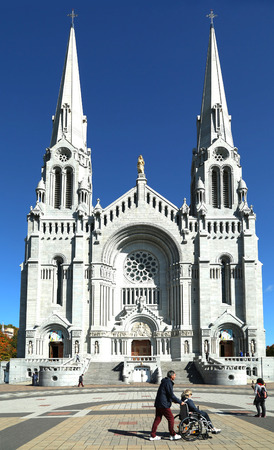 credited: QUEBEC-CANADA 16 SEPT 2016: Basilica of Sainte-Anne-de-Beaupre in Quebec, Canada.  It has been credited by Catholic church with many miracles of curing the sick and disabled.