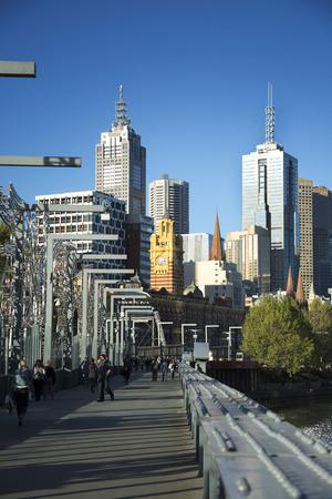 footbridges: MELBOURNE, AUSTRALIA - OCTOBER 14, 2016: Footbridge in Downtown Melbourne over the Yarra river in Australia with buildings in background.  Melbourne have many footbridges.