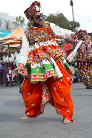 MELBOURNE, AUSTRALIA - OCTOBER 15, 2016:  Man dancing during an Indian dance demonstration at Federation square in Melbourne, Australia