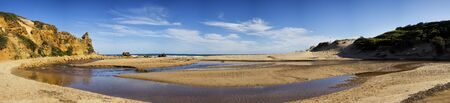 lonsdale: Panorama of a yellow sand rock and beach at Alreys inlet, Australia