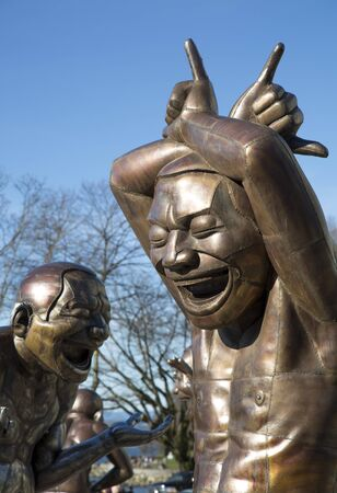 VANCOUVER, CANADA, February 8, 2016: Yue Minjun is share of Cynical Realism, Chinese artistic movement in response to 1989 demonstrations in Tiananmen. The bronze characters Depict the artists own face