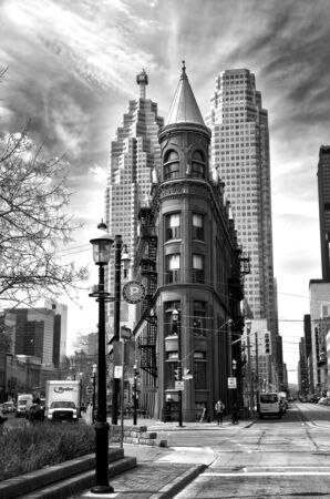 TORONTO CANADA JULY 10, 2017:  Gooderham Building is a historic landmark of Toronto, Ontario, Canada and is the focal poin in black and white Editöryel
