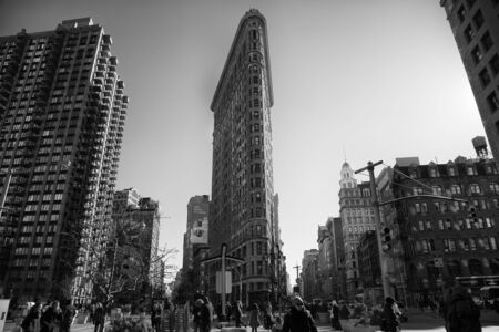 broadway tower: NEW YORK, USA - MARCH 24, 2017: The Flatiron Building is a triangular 22-story steel-framed landmarked building in the borough of Manhattan, New York, is considered to be a groundbreaking skyscraper.