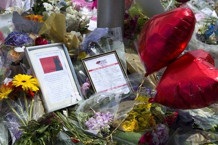 tributos: LONDON, UK - JUNE 7, 2017: Floral tributes laid at the site of the London terrorist attack at London Bridge on the 3rd of june 2017. Editorial