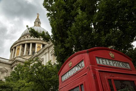 St-Pauls Cathedral and a red phone booth Stock Photo