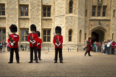 LONDON, UK - JUNE 7 , 2017: LONDON, UK - JUNE 7 , 2017: Royal Guards in Tower of London are the names given to contingents of infantry and cavalry soldiers charged with guarding the official royal residences in the United Kingdom