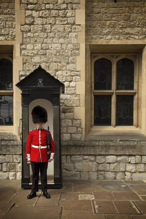 LONDON, UK - JUNE 7 , 2017: LONDON, UK - JUNE 7 , 2017: Royal Guard in Tower of London are the names given to contingents of infantry and cavalry soldiers charged with guarding the official royal residences in the United Kingdom