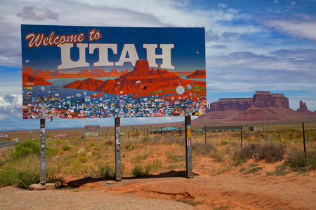 UTAH, UNITED STATES - JULY 24 , 2017: Utah sign across the road to Monument Valley  a region of the Colorado Plateau characterized by a cluster of vast sandstone buttes Editorial