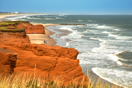 Red cliff in Havre Aubert with waves in the ocean in the St-Lawrence golfe